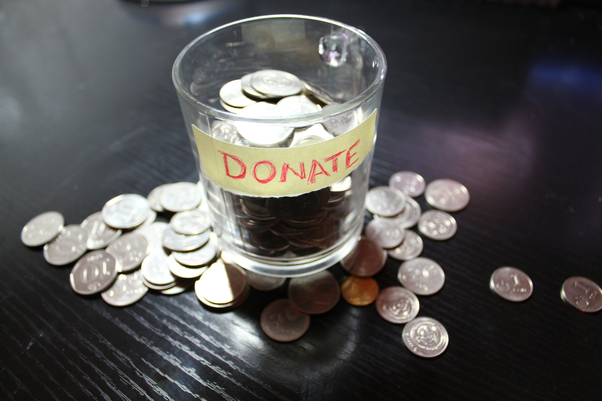 cup with change in it for donations